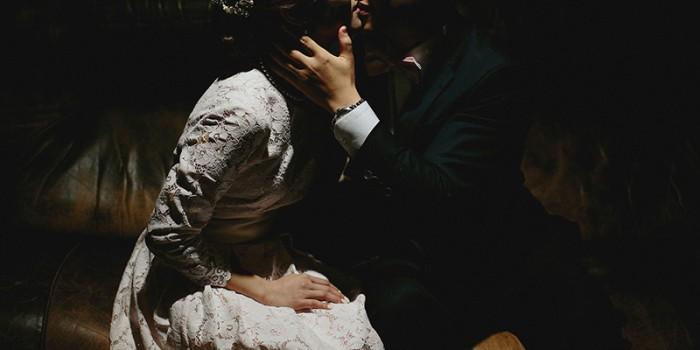 backyard wedding bride and groom kiss