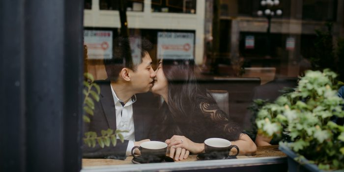 couple kissing in gastown coffeeshop